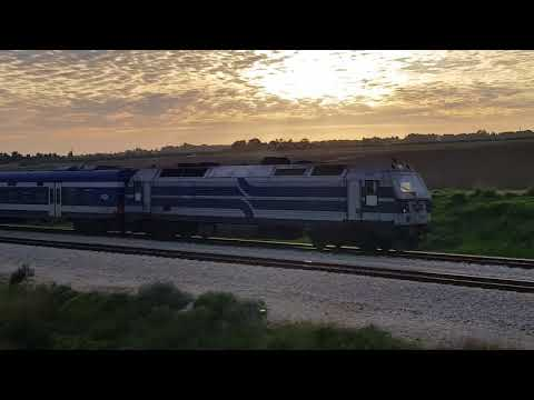 Israel Railways - The train to Tel Aviv enters Ramla Lod Station at an amazing sunset
