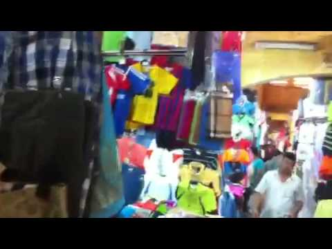 Buying shirts and shorts at Ben Thanh markets