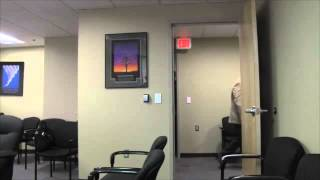 New Mexico attorney Willard Davis tries to bully photojournalist covering a public hearing.
