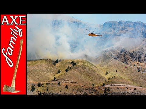 Helicopter and Firefighters Respond to Active Wildfire