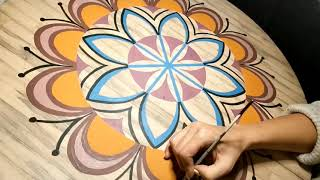 Mandala painting on a wooden table. 4 minutes time-lapse for two working days!