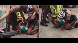 Brent Grimes wife HEADBUTTS COP at game Miami Dolphins