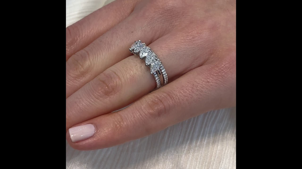 Floating Five Stone Pear Shape Diamond Band
