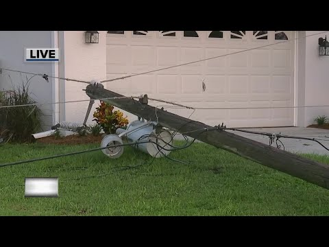 Power lines down across home's driveway in Lehigh Acres
