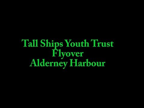 Tall ships flyover in Alderney Harbour