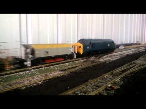 Model Railways - 72000 Clan Buchanan & 37038 pass by