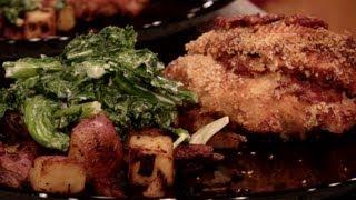 69. Cajun Stuffed Chicken, Brie Saganaki, Cajun Potato Hash, Creamy Mustard Greens