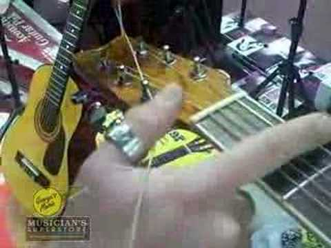 How to Change a Guitar String - George's Music