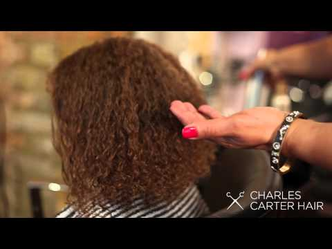 Blow dry curly hair straight