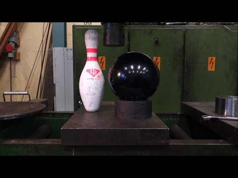 Crushing bowling ball and pin with hydraulic press