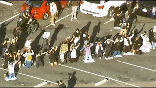 Thousands of protesters shut down I-8 San Diego freeway and surround La Mesa Police Headquarters