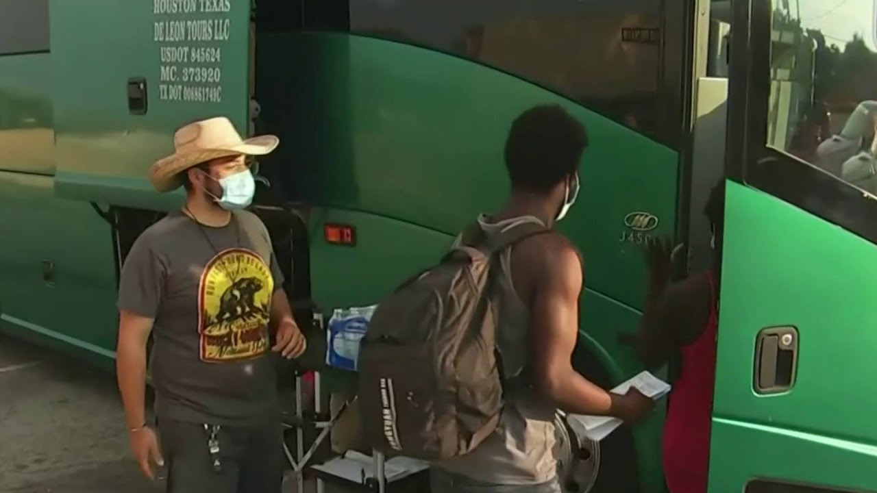 Houston volunteers help Haitians coming from Del Rio for next part ...