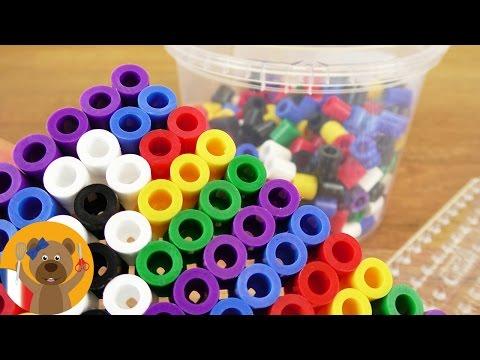 Idée de bricolage avec des perles à repasser XXL Hama   Lettre de l'alpabet avec fond coloré