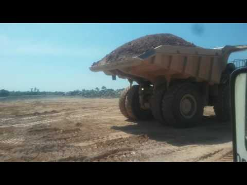 Cat 785D dumping waste