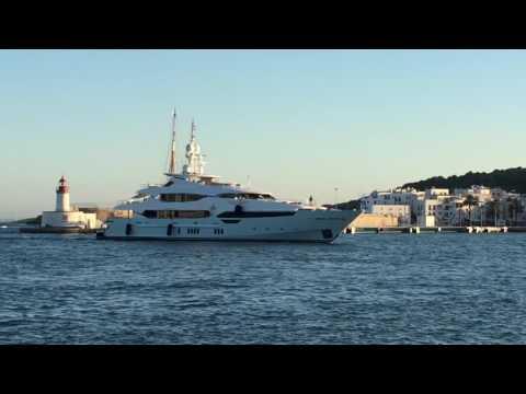 BLUSH Sunseeker 155 belonging to Eddie Jordan cruising in to Marina Ibiza to dock