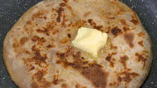 Closeup shot of butter melting on a stuffed parantha