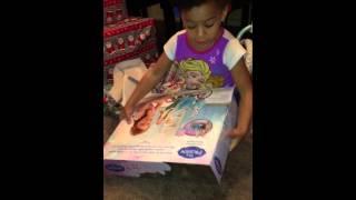 Daughter opening up frozen bike gift