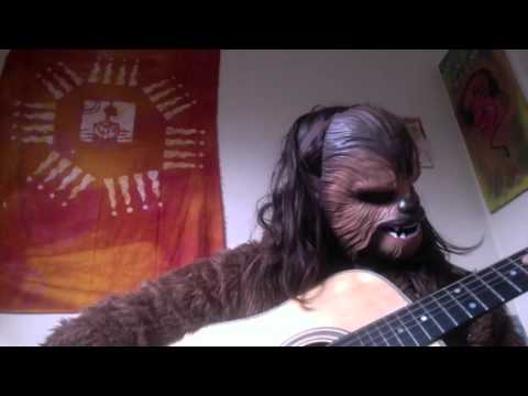 Chewbacca Plays the Star Wars Theme Song on Acoustic Guitar