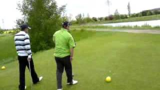 Mark shows Paul how to hit a ball. Thumbnail