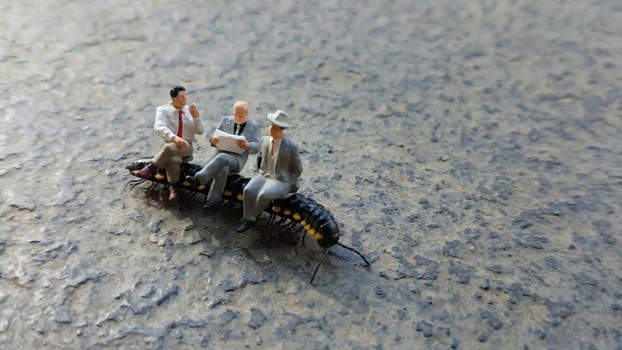 Figurines Ride Centipede to Work