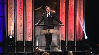 robert downey jr presents don cheadle with abff excellence in the arts award