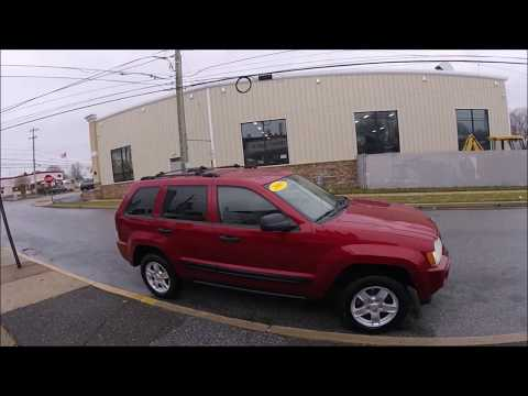 2005 Red /Tan Jeep Grand Cherokee Laredo 4WD (1J4HR48N85C) with an 4.7L V8 SOHC 16V engine, 5-Speed Automatic Overdrive transmission, located at 577 Chester Pike, Prospect Park, PA, 19076, (610) 237-1015, 39.886154, -75.302338 - Photo #0