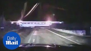 Hearth-stopping moment driver dodges train in police chase - Daily Mail