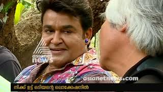 Legendary photographer Nick Ut visits Mohanlal on the sets of his film 'Odiyan'