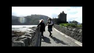 Jimi McRae playing the Bagpipes at Eilean Donan Castle. Special guest -Susanne Klimt