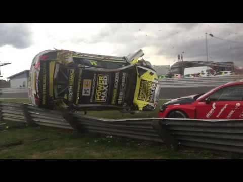 Scary footage shows race car flipping off track, hitting camera stand