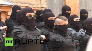 Ukraine: Azov battalion prepare for Mariupol deployment(20140603-056 W/S Members of Azov battalion walk past press corps C/U Members of Azov battalion W/S Members of Azov battalion M/S Members of Azov ..., 2014-06-03T15:29:49.000Z)
