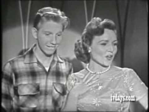 Betty White and Jimmy Boyd singing With A