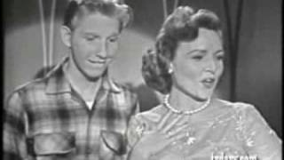 Betty White and Jimmy Boyd singing With A 'No' That Sounds Like 'Yes'
