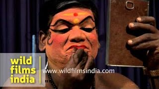 Kathakali performers applying makeup