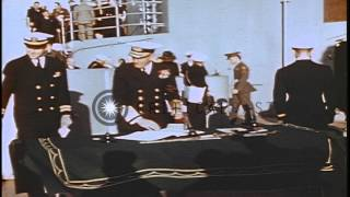 Ships underway and the Missouri blimp in flight overhead at the Brooklyn Navy yar...HD Stock Footage