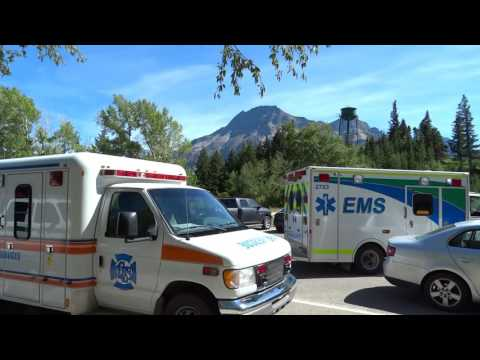 Waterton Alberta Ambulance and Fire Engine on scene near bears hump.
