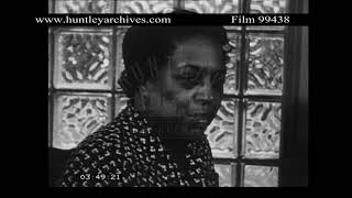 Edith Sampson having dinner with her husband.  Archive film 99438