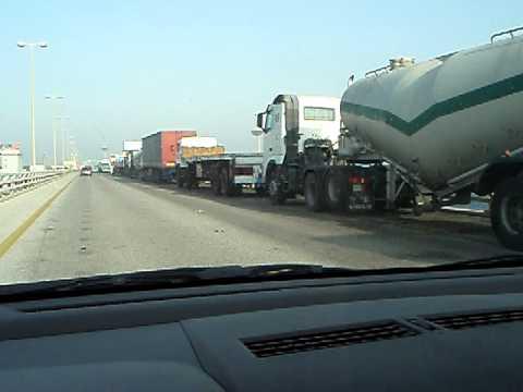long line of trucks on the Bahrain causeway