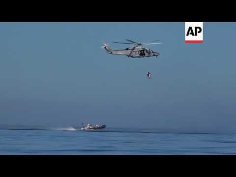 Italian Coast Guard rescue ailing migrant woman
