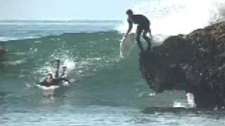 Homer Henard Acid drops from a rock on a Surfboard