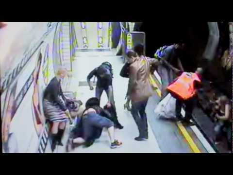 Man pushes a woman on the train field!