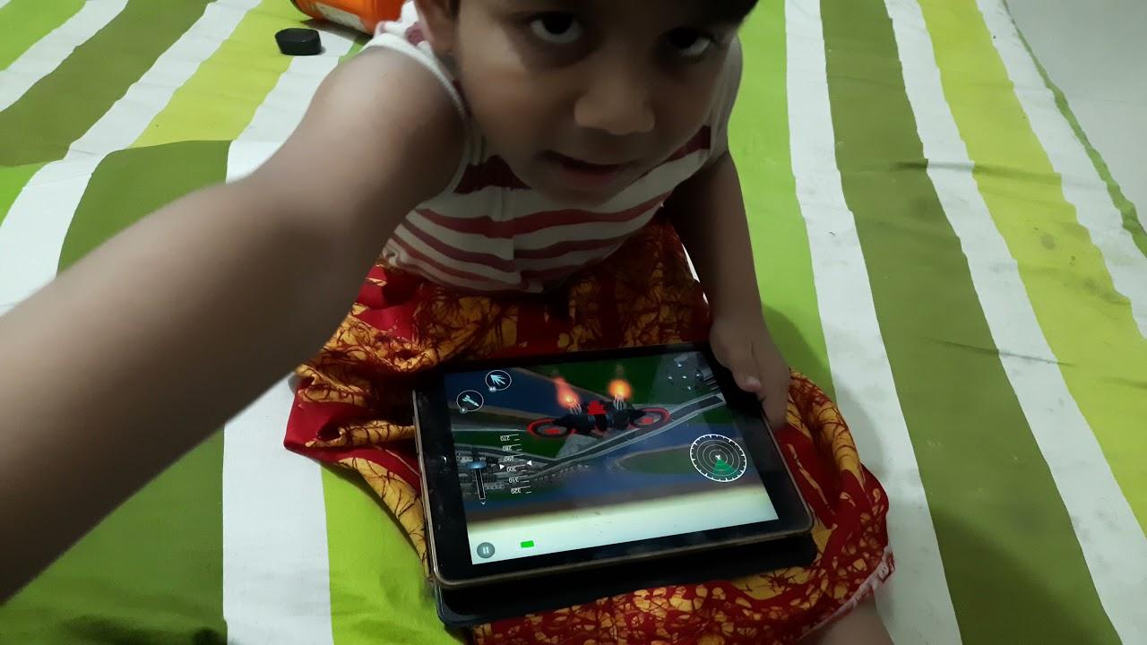 Tanjir play games in his Ipad