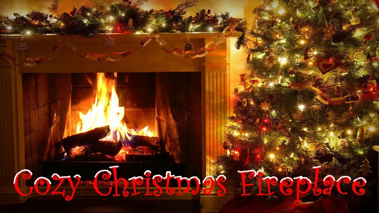 cozy crackling fireplace with christmas decorations tree garland lights