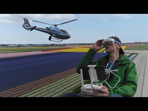 Download Youtube: Avoiding a helicopter while filming Dutch tulip fields with the Phantom 4 Pro.