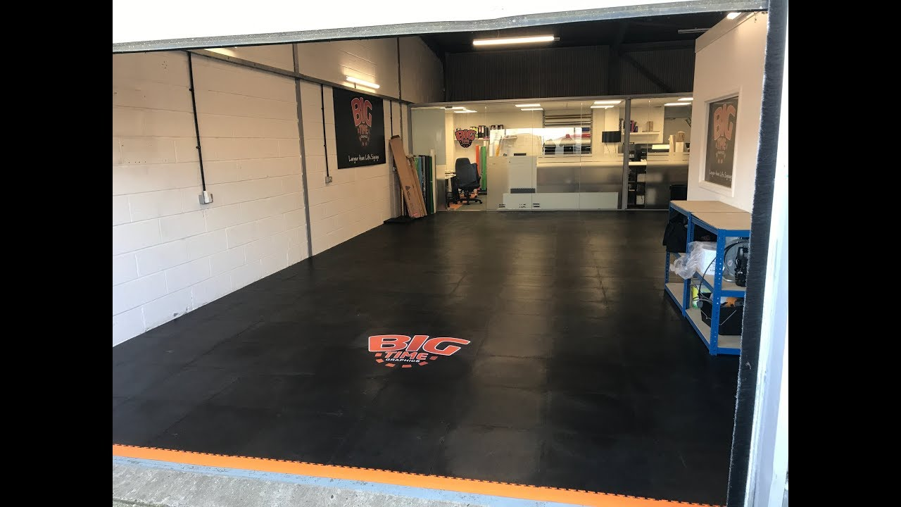 Black Orange Pvc Floor Tiles Installed For Big Time Graphics