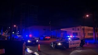 Dallas police headquarters hit with automatic gunfire