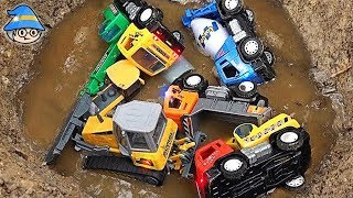 Car toys in the water. Play construction site vehicle and sand muddy play.