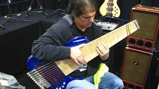 NAMM 2013 - Dude tries to play gnarly multi-string bass guitar