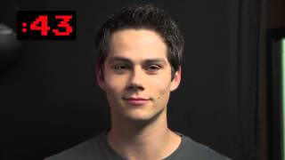 Dylan O'Brien staring at the camera, trying not to laugh