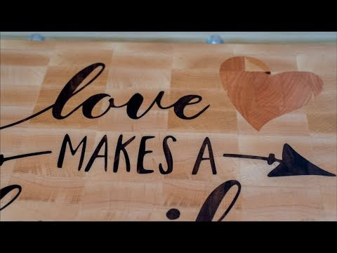 Personalized inlaid cutting board as a wedding gift. CNC Woodworking. Wood inlay. Cnc inlay
